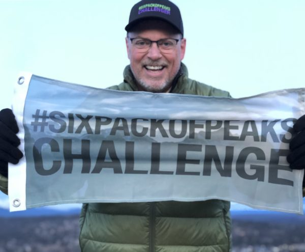 Jeff with the Six-Pack of Peaks Summit Flag